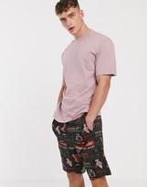 Asos Design ASOS DESIGN lounge pyjama shorts in black with motel print-Multi
