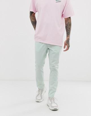 Asos Design DESIGN skinny pants with elastic waist in light green nylon
