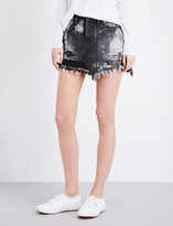 Tortoise Denim Distressed denim mini skirt