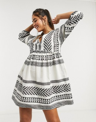 Accessorize mini smock beach dress in white and black aztec pattern