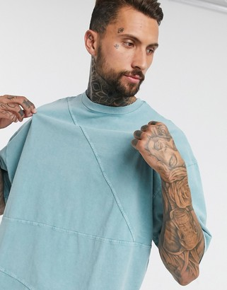 ASOS DESIGN oversized t-shirt with half sleeve in heavyweight blue acid wash with seam detail