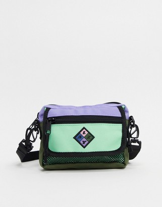 Lazy Oaf zip flap cross body bag in mint and lilac