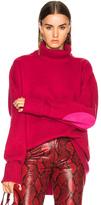 Maison Margiela Oversized Sleeve Turtleneck Sweater in Pink.