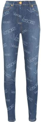 Versace all-over logo print skinny jeans