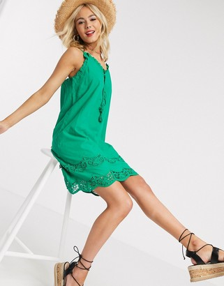 Gilli mini sun dress with lace detail in green