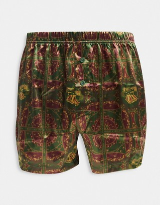 ASOS DESIGN Christmas boxer shorts in printed satin