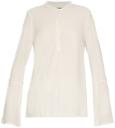 Raquel Allegra Frayed-edge crepe collarless blouse