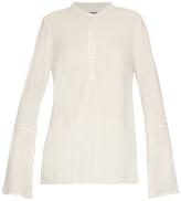 Raquel Allegra Frayed-edge crepe collarless blouse