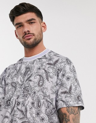 Asos DESIGN relaxed longline t-shirt with all over floral and paisley print in lilac linen look