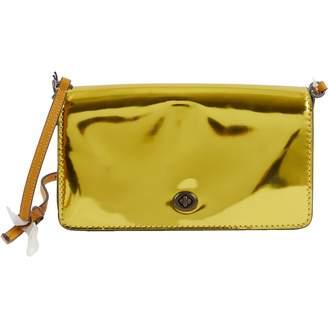 Coach Gold Leather Handbags