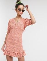 Faithfull The Brand Faithfull margherita floral short sleeve shirred mini dress in pink