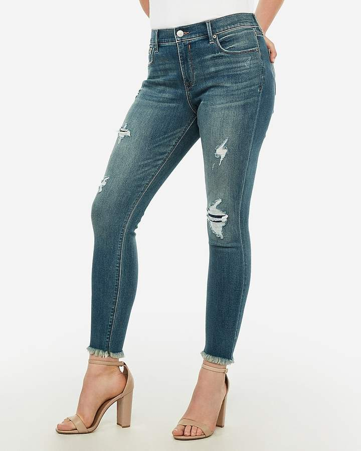 great variety models limited price arrives Mid Rise Denim Perfect Curves Ripped Raw Hem Ankle Leggings