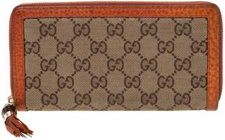 Gucci Beige/Orange GG Canvas and Leather Tassel Zip-around Continental Wallet