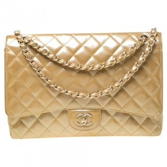 Chanel Timeless/Classique Yellow Patent leather Handbags