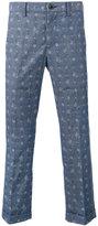 Sacai Aloha printed trousers