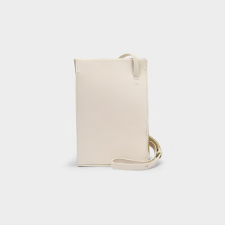 Most Wanted Design by Carlos Souza Twisted Bag In Beige Leather