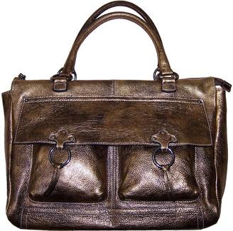 Innue' Innue Gold Leather Handbags