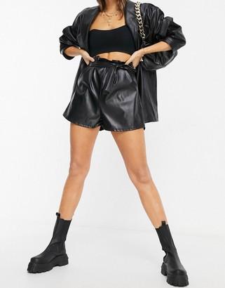 Flounce London paper bag waist vinyl shorts in black