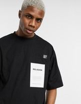 Religion oversized t-shirt with graphic pocket in black