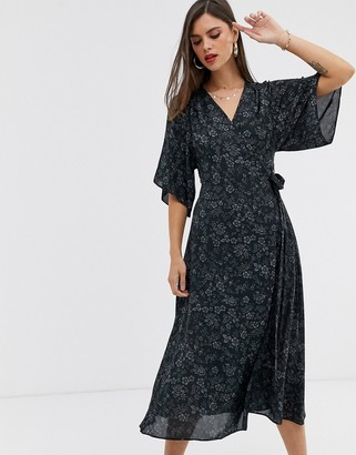 Liquorish wrap front midi dress with tie belt and flutter sleeves in black floral