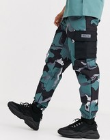 Nicce cargo trousers in camo-Green