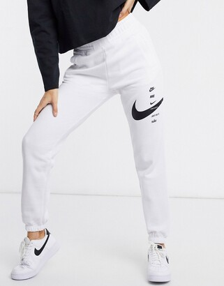 Nike swoosh oversized joggers in white