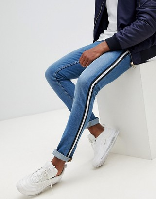 Asos DESIGN super skinny jeans in mid wash blue with side stripe