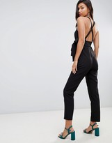 Asos Design DESIGN wrap front jumpsuit with peg leg and self belt with cross back