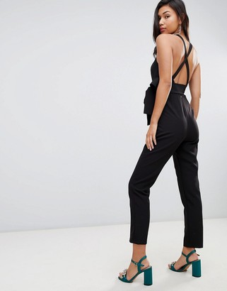 ASOS DESIGN wrap front jumpsuit with peg leg and self belt with cross back