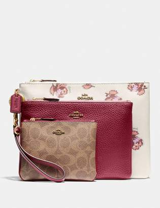 Coach Triple Pouch In Signature Canvas And Floral Print