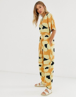Asos DESIGN zip front slouchy tie waist boilersuit with pockets in animal print