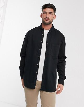 Asos DESIGN stretch regular organic denim shirt in black