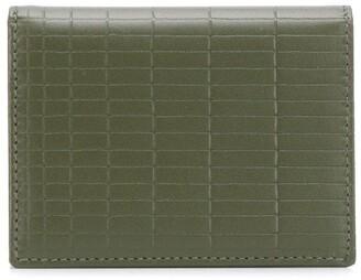 Comme des Garcons engraved design wallet