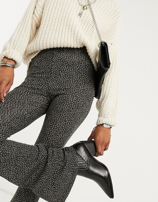 Topshop ditsy floral flared trousers in black
