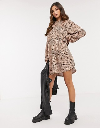 ASOS DESIGN mini dress with frill neck spot swing dress in camel and black spot