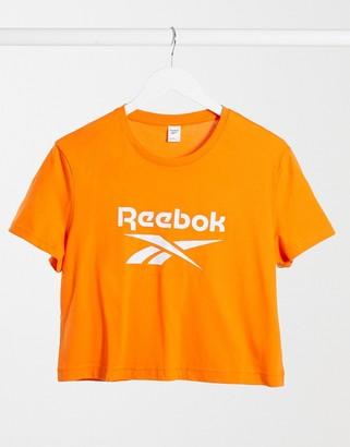 Reebok large logo cropped t-shirt in orange