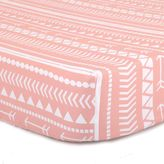 The Peanut Shell Tribal Fitted Crib Sheet in Coral