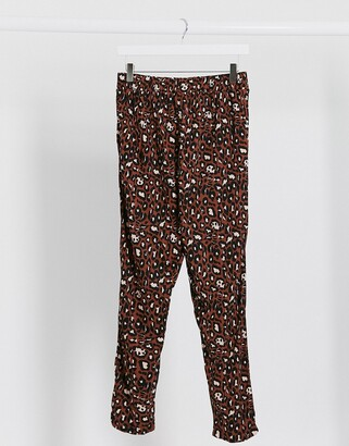 ASOS DESIGN jersey peg pants in animal print