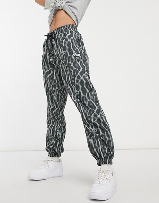 Nike woven pants with animal print in gray