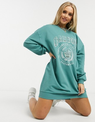 ASOS DESIGN oversized sweatshirt dress with varsity graphic in sage green