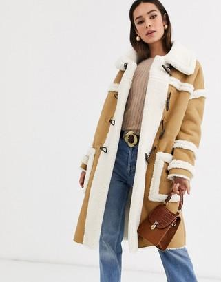 Glamorous longline coat with borg detail
