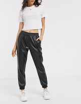 Pieces leather look sweatpants in black