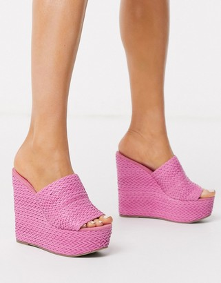 ASOS DESIGN Title woven wedge mules in pink