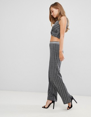 Flounce London high waisted trousers with elasticated waist in silver metallic