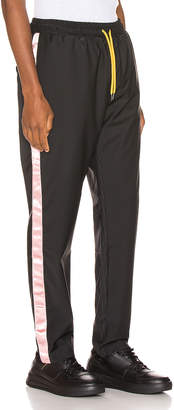 Pyer Moss Patched 50/50 Lounge Trouser in Black & Dusty Pink | FWRD
