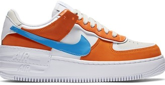 Nike Force 1 Shadow trainers in rust and blue