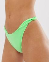 Asos DESIGN mirror satin knot bikini bottom in apple green high shine