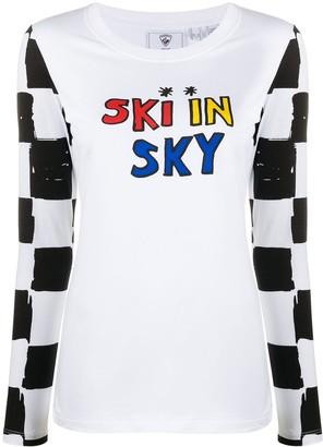 Rossignol x JCC ski in sky print top
