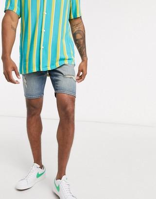 ASOS DESIGN skinny denim shorts in vintage dark wash blue with rips
