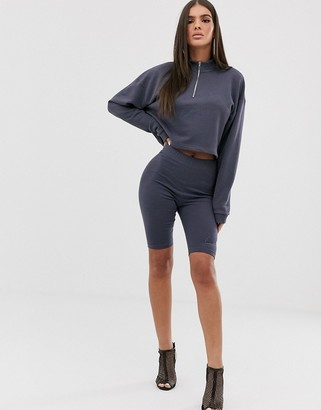 Couture The Club bodycon motif short in washed navy